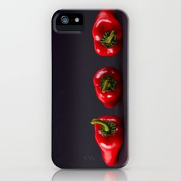 Red peppers on a black background iPhone Case
