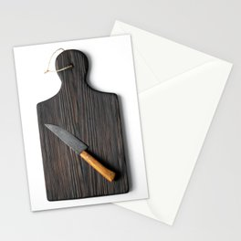 Cutting board with a knife on a white background Stationery Cards