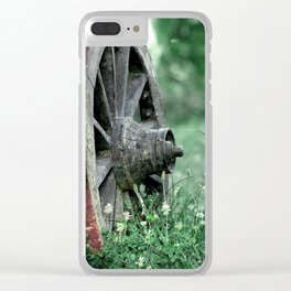 The old wheel, abandoned retro wooden farm cart wheel in the meadow photo Clear iPhone Case