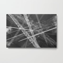 Jet vapour trails in a dark sky Metal Print