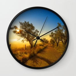 Misty road to the sun Wall Clock