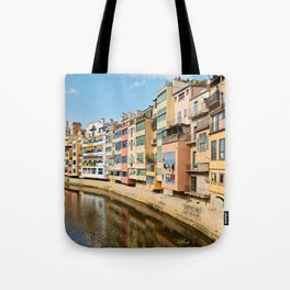 Colorful houses and reflected in water in Girona Tote Bag