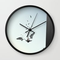 monster inc Wall Clocks featuring Icarus, Inc. by Great Opportunitees
