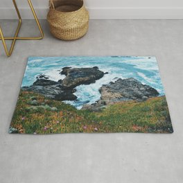 Standing on a Cliff Rug