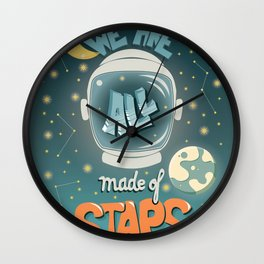 We are all made of stars, typography modern poster design with astronaut helmet and night sky, green Wall Clock