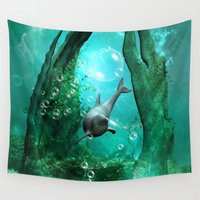 swimming Wall Tapestries featuring Swimming dolphin by nicky2342