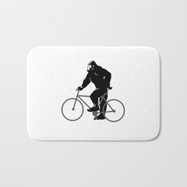 Bigfoot  riding bicycle Bath Mat