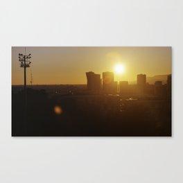 Sunset behind city skyline. Canvas Print