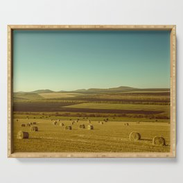 Farm field with hay bales Serving Tray
