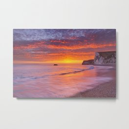 Cliffs at Durdle Door beach in Southern England at sunset Metal Print
