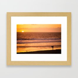 Surfer watching sunset in Southern California Framed Art Print
