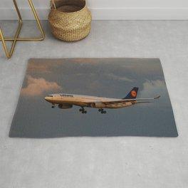 A Lufthansa Plane Peparing For Landing Rug