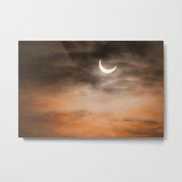 Partial solar eclipse and clouds morning sky Metal Print