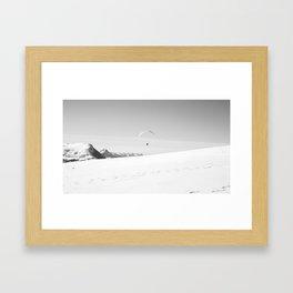 Flying above the snow Framed Art Print