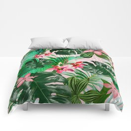 Tropical palm leaf with red flowers Comforters