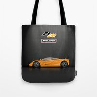 f1 Tote Bags featuring McLaren F1 LM by vsixdesign