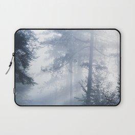 Sun rays shinning through foggy forest Laptop Sleeve