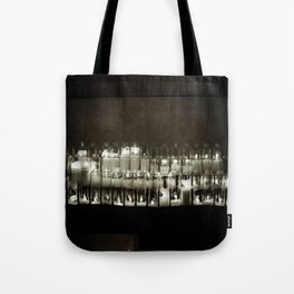 It seems to me, you live your life, like a candle in the wind. Tote Bag