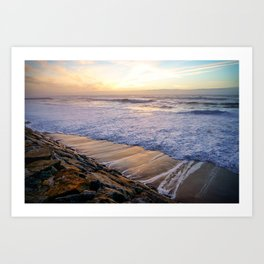 White waves crashing into mossy rocks, with a beautiful autumn sunset. Art Print