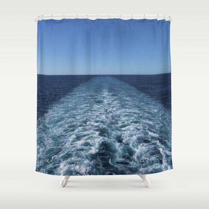 SEA BLUE WAKE AND HORIZON