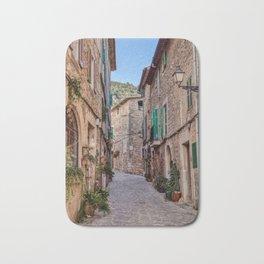Narrow street in Valldemossa village - Mallorca, Spain Bath Mat