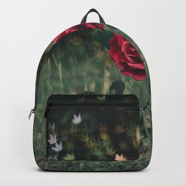 Single Red Rose In A Grassy Field With Bokeh Maple Leaves In The Background Backpack