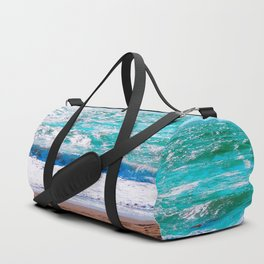 sandy beach with blue water and blue sky in summer Duffle Bag