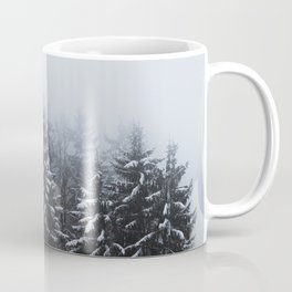 Fog over snow covered spruce forest in winter Coffee Mug