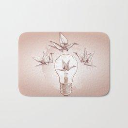 Origami paper cranes and light Bath Mat