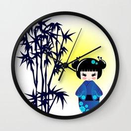 Japanese kokeshi doll at bamboo at sunrise Wall Clock