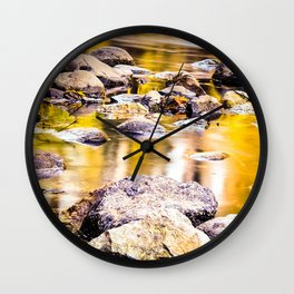 rock and stone in the river with the summer sunset light Wall Clock