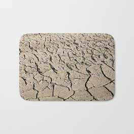 cracked earth in the field Bath Mat