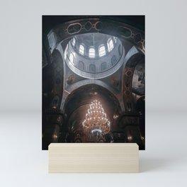 Chandelier in the church Mini Art Print