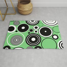 Geometric Black And White Rings On Pastel Green Rug