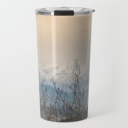 Snowy mountains through the trees Travel Mug