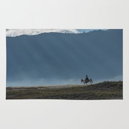 The lonely horse rider at Bromo, East Java, Indonesia Rug