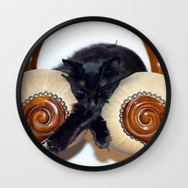 Relaxed Black Cat Sleeping Between Two Chairs  Wall Clock