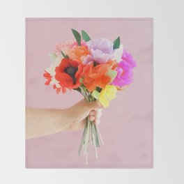 Hand holding paper flowers Throw Blanket