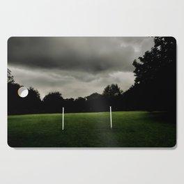 Football goalposts in an empty field Cutting Board