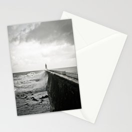 Waves break against an English pier Stationery Cards