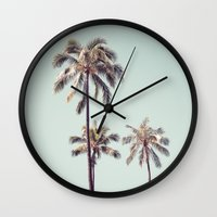 palm trees Wall Clocks featuring palm trees by noirblanc777