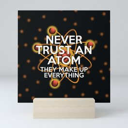 Never trust an atom. They make up everything. Mini Art Print