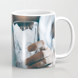 Bartender prepares a cocktail in the nightclub. Expert barman is making cocktail at night club. Coffee Mug