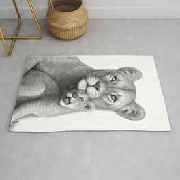 Lioness with a baby Rug