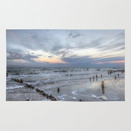 Cold sundown at the beach Rug