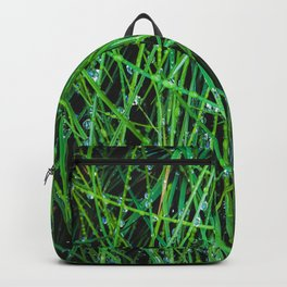 closeup green grass field texture with raindrops Backpack