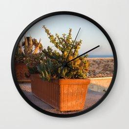 Flowerpots on the terrace Wall Clock