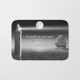 A smooth sea never made a skillful sailor Bath Mat
