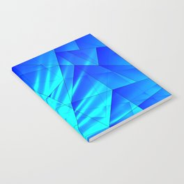 Bright sunshine on celestial and blue triangles of irregular shape. Notebook