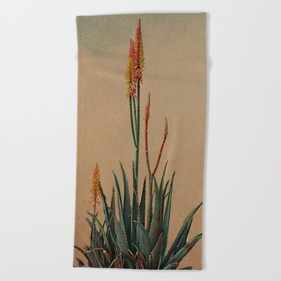 Blooming succulent. Beach Towel
